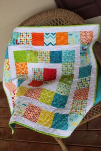 Around the world baby quilt made with charm packs ...