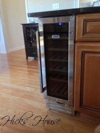 built-in wine fridge, I like how it's on the end cap and ...