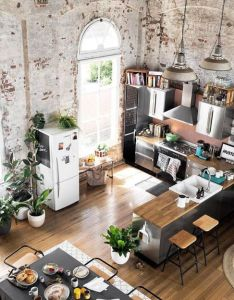 Converted warehouse makes for  stunning loft apartment exposed brick walls are soften with loads of indoor plants and timber furniture also alles fur ihren stil thegentlemanclub was mann so braucht rh pinterest