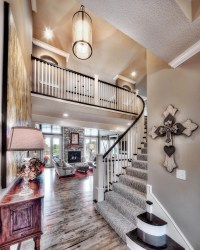 Entry: curved staircase, open floor plan, pendant lighting ...