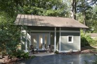 This little backyard cottage feels spacious despite a ...
