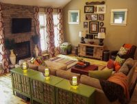 A warm living room featuring green and orange earth tones ...
