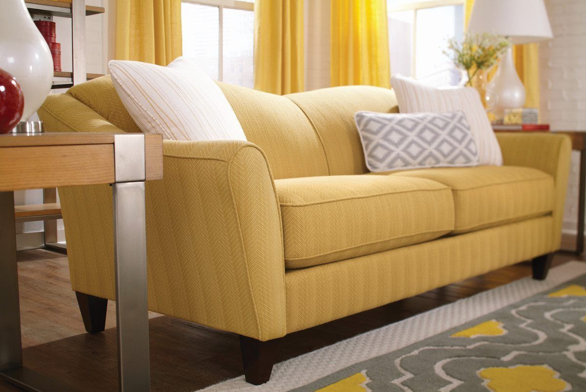 yellow sofa table sofas online canada furniture lazyboy with white pillows and a