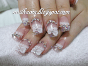 pretty nail design with charms
