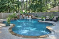 peaceful freeform pool and waterfall with tanning ledge by ...