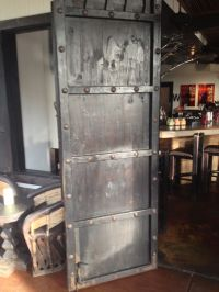 pallet wood barn door with metal rivets and stained black ...