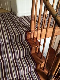 Stripy carpets for stairs and landing.  Loved and pinned ...