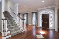 cherry hardwood flooring and grey walls
