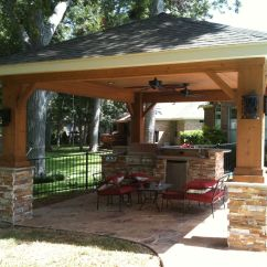 Outdoor Kitchen With Freestanding Grill Wheeled Island Patio Cover Featuring Stonework And An