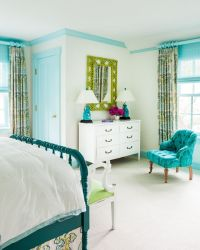 Blue teen girl's bedroom features white walls finished ...