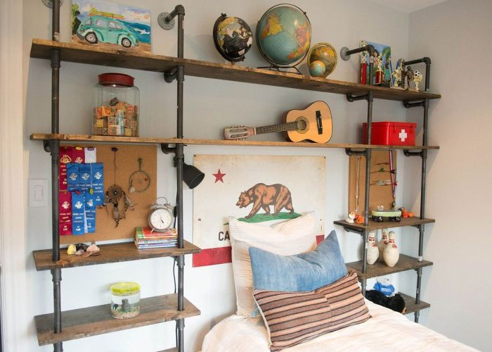 Eclectic boy   bedroom features an industrial pipe and wood shelving unit which frames the headboard less bed highlighted by   also pin megan dalydesigns on kids pinterest saint james