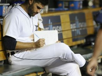 Image result for jd martinez taking notes in dugout