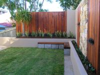 Inner city Brisbane courtyard surrounded by Merbau decking ...