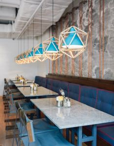 less expensive way to customize lighting build around it also pair of swinging sofas greet you at this restaurant rh pinterest