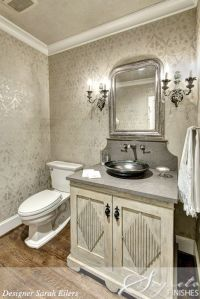 This powder room mixes old world with a bit of shimmer ...