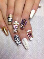 black nail art stiletto nails gold