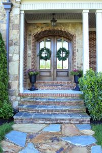 Double arched front doors, stone path, urn planters | DIY ...