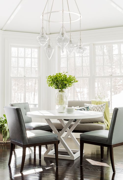 Sun Filled Breakfast Nook Is With A Staggered Glass Jewels Chandelier Illuminating Round White