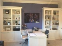 Custom office with his and hers desks and bookshelves ...