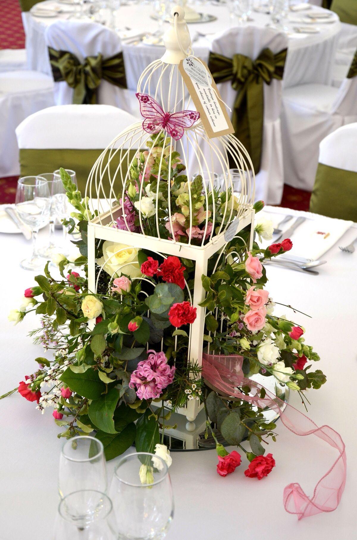 Jaula flores centro de mesa  Flores paisajes centros de