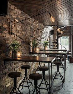 Wood ceiling polished concrete floor exposed brick wall light fixtures inspirational design loft living bar warehouse home magazine also  love the decor in this cafe particularly lighting rh pinterest