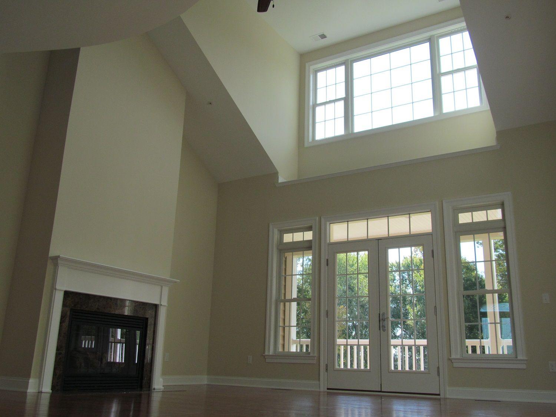 Living Room Two Story With Dormer & Sloped Ceilings. Room