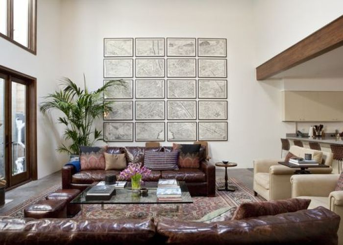 How to fill  double height living room two large sofas arm chairs ottomans glass coffee table anchored by gigantic antique persian also south shore decorating blog what  love wednesday classically