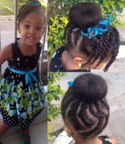 cornrow bun hairstyle with twisted