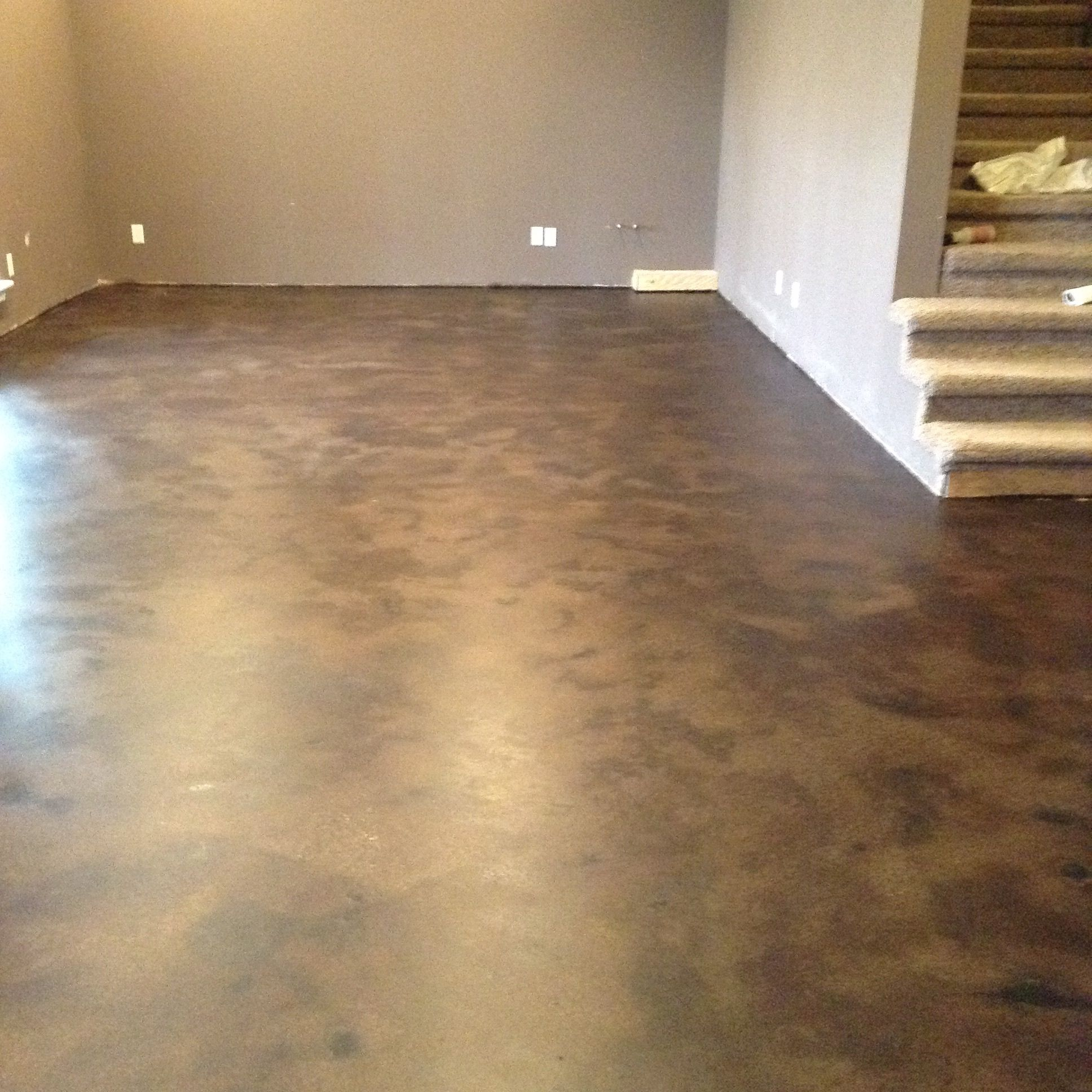 Basement Stained Concrete Floor Used as an entertainment