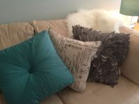 Throw pillows on cream couch - teal pillow, cream with ...