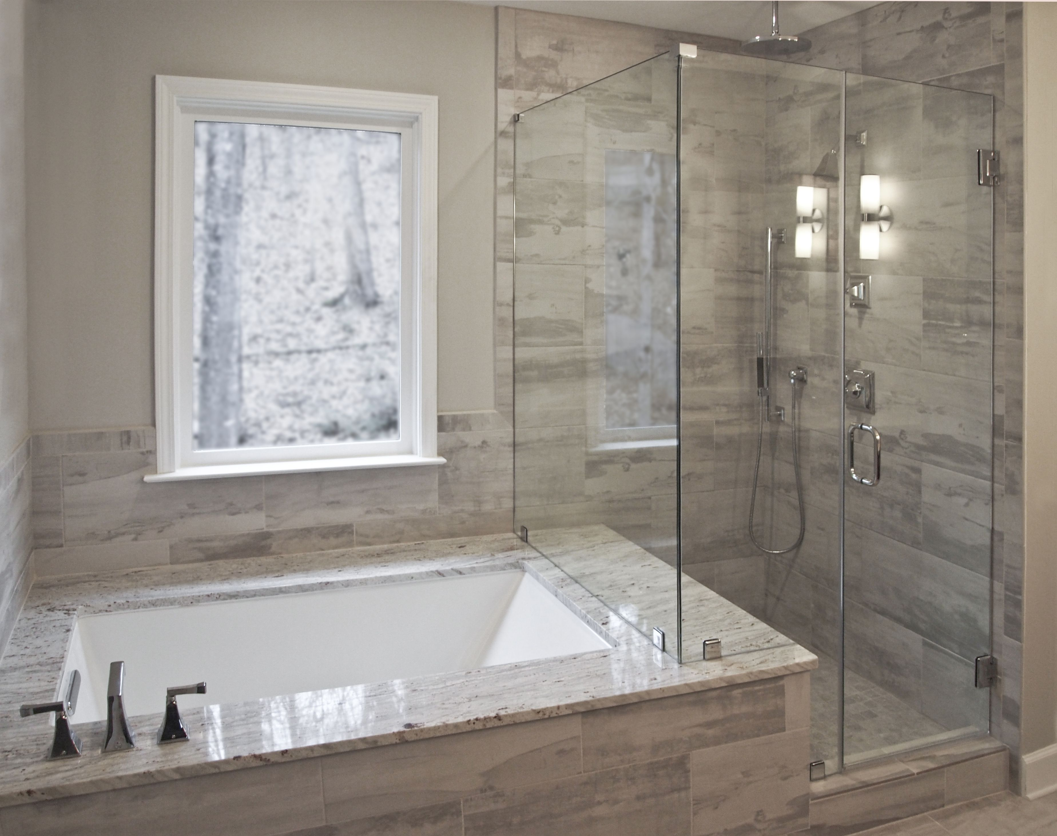 Bathroom remodel by Craftworks Contruction. Glass enclosed
