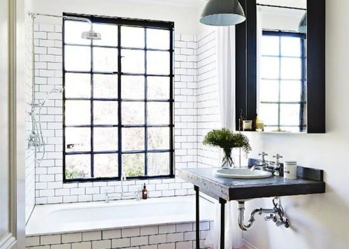 Window pane steel glass in this shower and tub combo white subway tile with dark grout looks like  vintage bathroom also gorgeous modern rustic tiles  wood floors