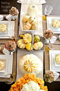 Fall Table--White plates, pumpkin and gourds in baskets ...