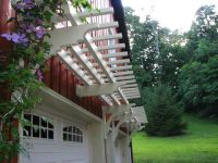 Wall mounted garage trellis with a clematis vine | Arbors ...