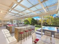 Outdoor kitchen and entertaining area with tiled covered ...
