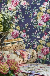 A large scale, bold, multi-coloured floral wallpaper ...