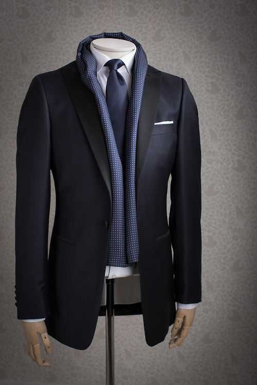 Blue textured silk scarf paired with suit, tie, and pocket