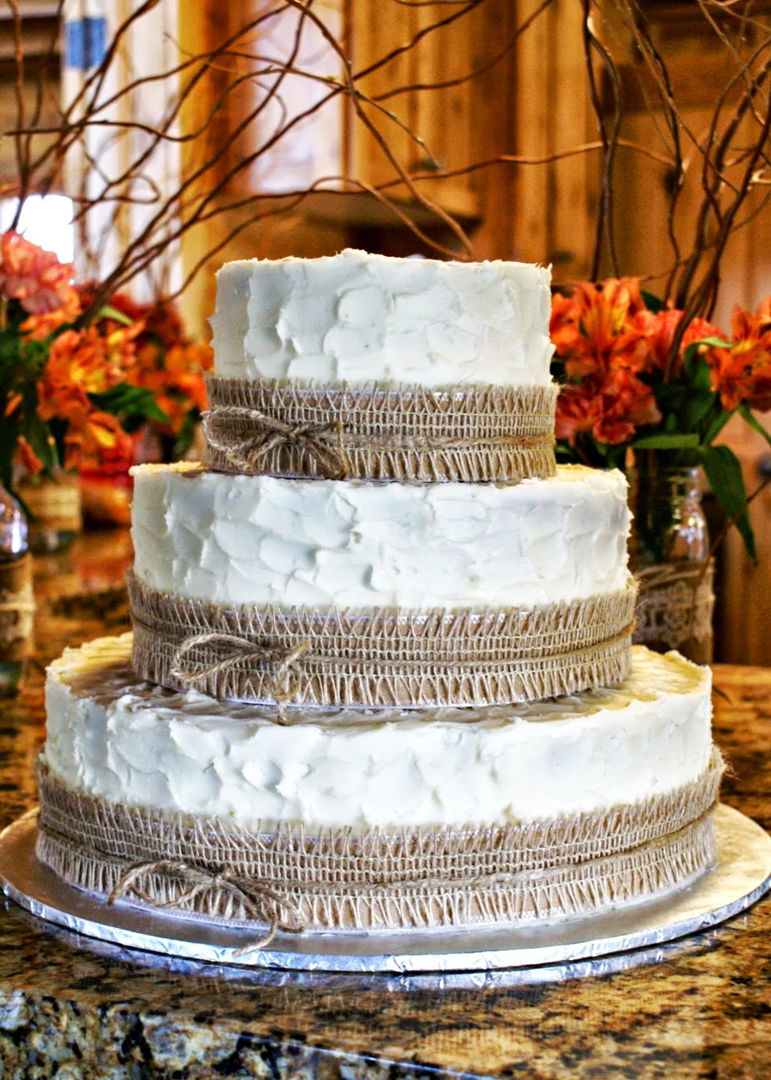 Rustic Burlap Wedding Cake With Lace Ribbon Around The