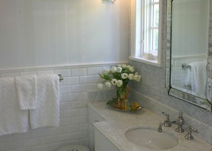 Pale blue walls paint color beveled subway tiles backsplash white bathroom cabinet with glass knobs marble counter tops garden stool and also image small shower tile basketweave floor