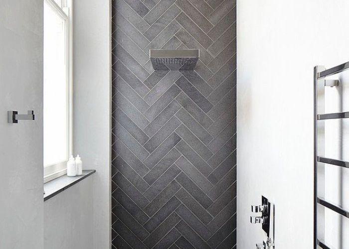 Dark tile in herringbone pattern  narrow space maybe or    also