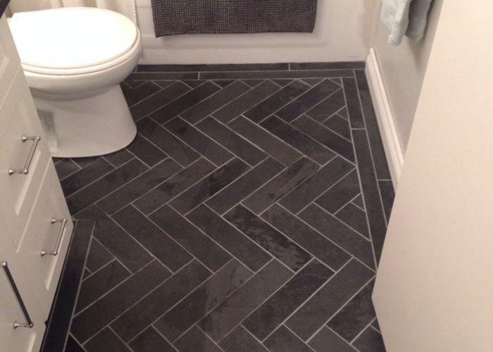 Charcoal gray herringbone honed marble floors in the bathroom for my floor also www