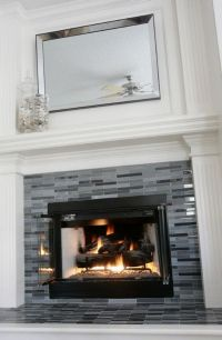 Updated fireplace. Grey & black glass tile. #decor #tile #