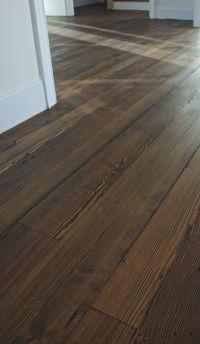 Antique Heart Pine flooring shown with a dark stain ...