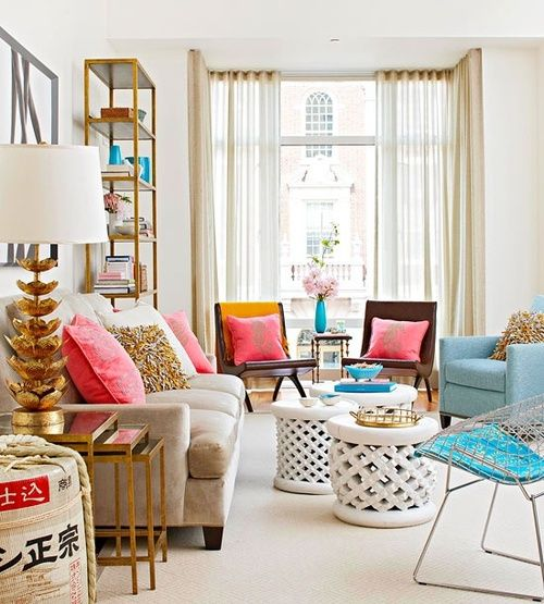 This city apartment living room looks fabulous decked out in pink cool toned turquoise and glitzy bronze accents love it pop of color the home also  idea using  cluster smaller tables place rh pinterest