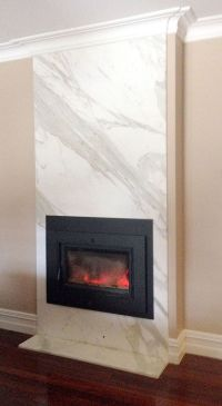 Fireplace clad in Calacatta marble, made by Marable Slab ...