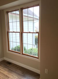 Wood windows, white trim. Shaw laminate floor in