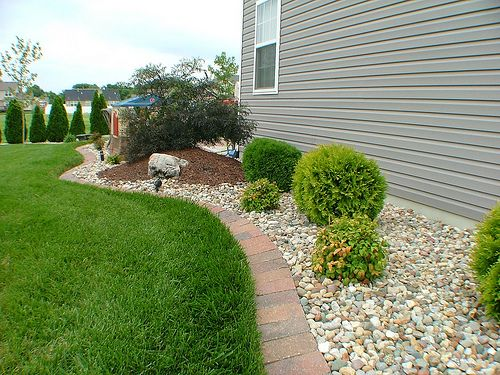 Landscaping Along The Side Of A House With Riverrock Plasko