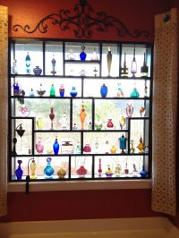 Perfume bottles display on window   Perfume Bottles ...