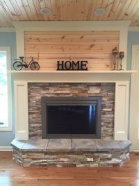 Fireplace update with stacked stone, painted wood, and ...