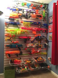 Nerf gun wall display. This was made from slat wall board ...
